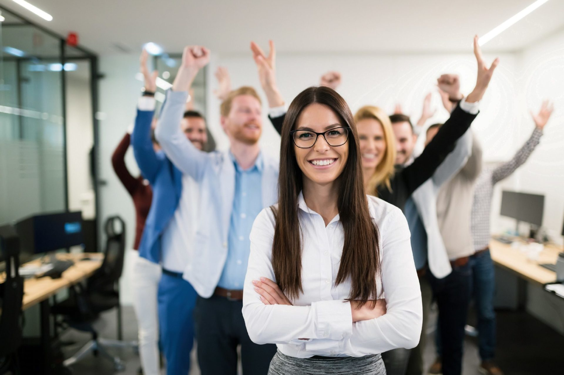 Mental Health. An image of a group of employees smiling at the camera and celebrating